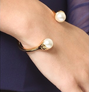 MLBR-02141 imitation pearls accent the tips of this Tory Burch cuff
